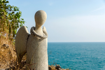 Guardian angel statue on the cliffs of the island, Thailand.