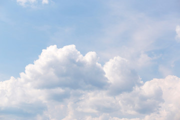 light Blue sky with white close-up clouds