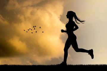 girl running silhouette at sunset