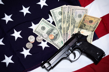 Flag of the USA with gun and money