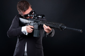 Male gangster aiming machine gun at someone