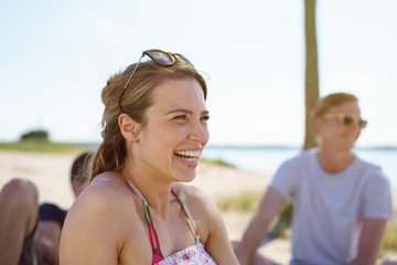 Happy natural young woman having a good laugh