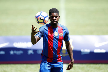 FC Barcelona's newly signed soccer player Samuel Umtiti plays wih a ball during his presentation at Camp Nou stadium in Barcelona