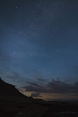 Starry night in the mountains, vertical photo