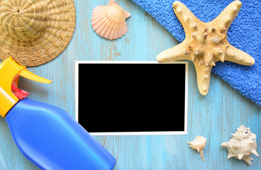 Photo with black background and beach accessories on a wooden table