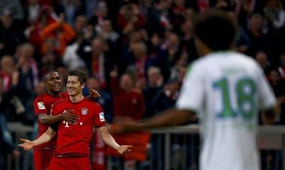 Bayern Munich's Robert Lewandowski reacts after scoring a goal during their German first division Bundesliga soccer match against Wolfsburg in Munich