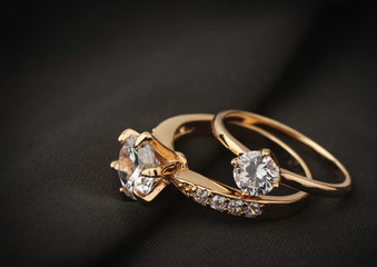 jewelry rings with diamond on black cloth, soft focus