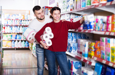 Man and girl selecting toilet paper