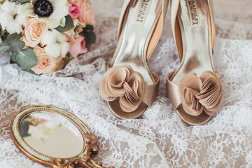 Luxury shoes and bride jewel on the sofa