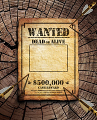 Wanted poster on wooden surface