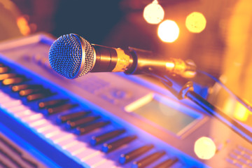 Live music background.Microphone and piano  keyboard on stage.Concert and musical instrument