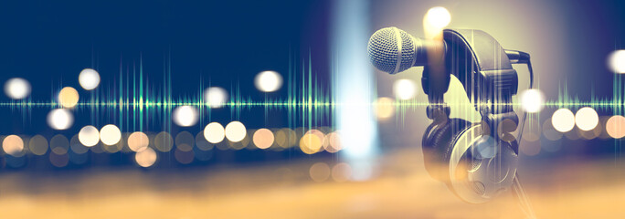 Music background.Microphone and headphones.Live music and blurred stage lights