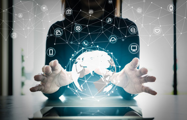 Close up hand's woman over digital planet global connection with communication network application icon,  internet of things (IoT) and Digital era. Marketing 4.0