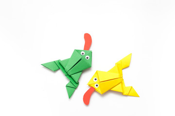 Frogs folded from colored paper in origami technique