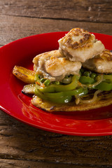 Tucunare fish in butter with green peppers and banana - Traditional Amazonian dish