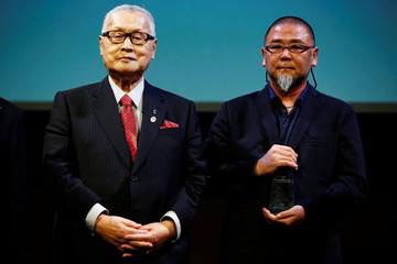 President of the Tokyo 2020 Olympic and Paralympic Games organizing committee Yoshiro Mori and artist Asao Tokolo attend the unveiling ceremony of Tokolo's emblem designs for the Tokyo 2020 Olympic Games and Paralympic Games in Tokyo
