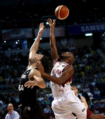 Argentina's Luis Scola jumps for the ball with Venezuela's Miguel Ruiz during their 2015 FIBA Americas Championship final basketball game