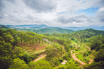 Fantastic landscape of Dalat Mountains, Viet Nam, fresh atmosphere, villa among forest, impression shape of hill and mountain from high view, wonderful vacation for ecotourism in spring