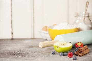 Mixed berries, baking ingredients and utensils
