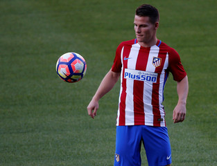 Atletico Madrid's newly signed soccer player Gameiro  plays with a ball during his presentation at Vicente Calderon stadium in Madrid