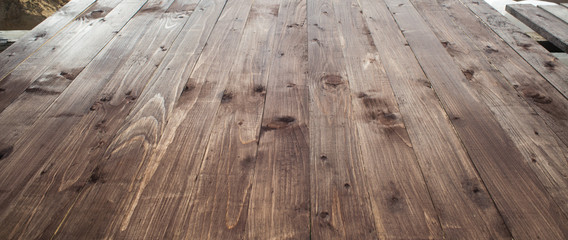 Wooden board empty table in front of blurred background. Perspective wood table.