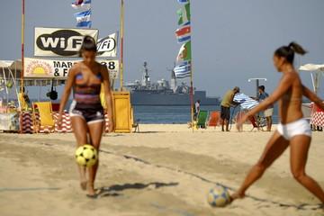 A navy ship patrols offshore Copacabana beach in Rio de Janeiro