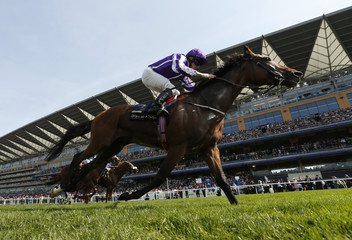 Ryan Moore wins the 4.20 Prince Of Wales' Stakes on Highland Reel