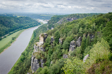 Panorama view from rocks Bastei to river Elbe and Rathen, Saxon Switzerland, Germany
