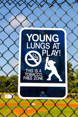 Sign asking people not to smoke in the ball park