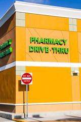 Bright green Pharmacy Drive Thru wall sign