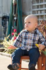 Baby Boy Sitting on Garden Chair