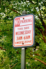 No Parking - This Side Wendesday 3am-6am Sweep Zone sign