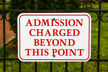 Admission Charged Beyond This PointRed and white sign