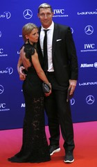 Former German handball player Kretzschmar with partner arrive for the Laureus World Sports Awards 2016 in Berlin