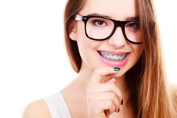 Happy nerdy teenage with brace wearing eyeglasses