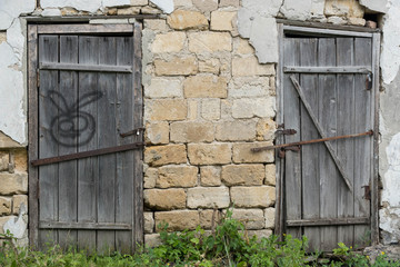 Old building for inventory on a farm with old wooden doors
