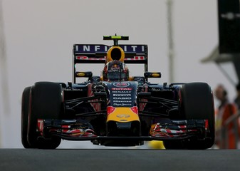 Red Bull Formula One driver Daniil Kvyat of Russia leaves the pit lane during the second free practice session of Abu Dhabi F1 Grand Prix at the Yas Marina circuit in Abu Dhabi