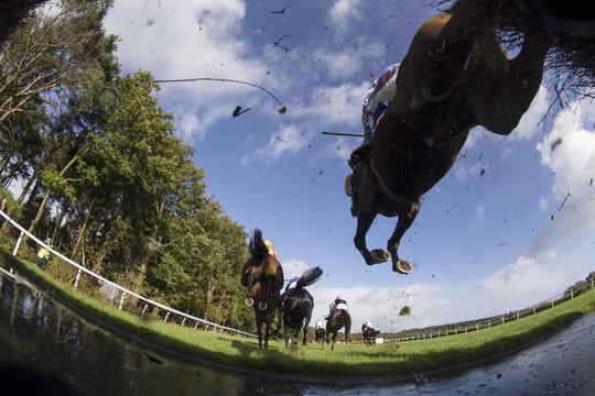 General view as runners clear the water jump during the 15.10 totepool Supporting The Sport You Love Beginners' Steeple Chase