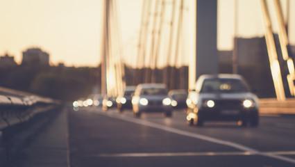 Cars driving on bridge road defocused image
