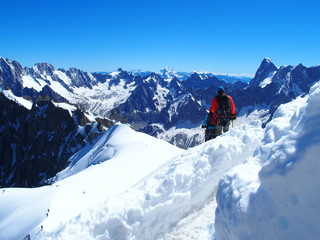 Two alpinists and mountaineer climber on Aiguille du Midi
