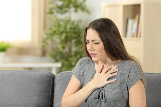 Woman suffering respiration problems