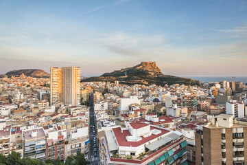 View of Alicante city center and Santa Barbara castle at the sunset, Spain