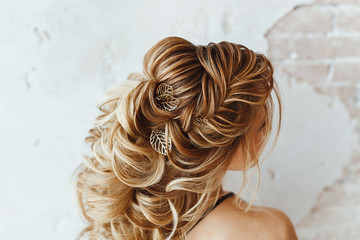 Close up detail of greek braid hairstyle, back rear view at hairdresser salon