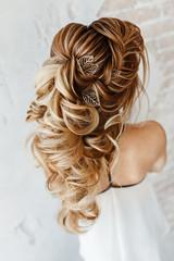Spoed Fotobehang Kapsalon Close up detail of greek braid hairstyle, back rear view at hairdresser salon