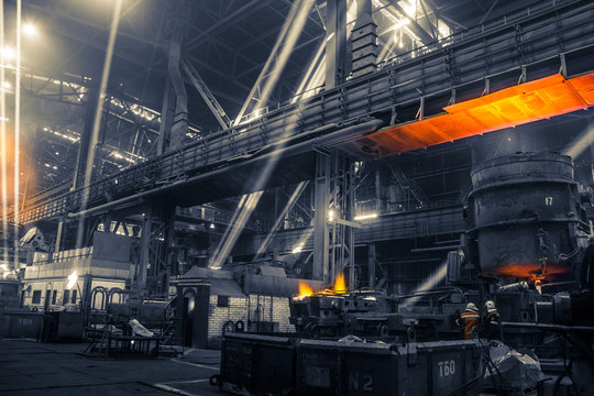 Iron and steel works factory with sun beam