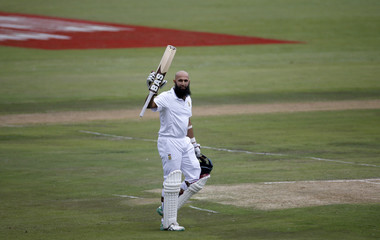 South Africa's Amla raises his bat as he celebrates his hundred century during the fourth cricket test match against England in Centurion
