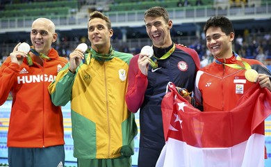 Swimming - Men's 100m Butterfly Victory Ceremony