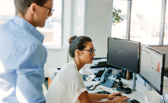 Business team working together on computer