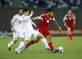 Tornike Okriashvili fights for the ball with Anthony Bardon during their Euro 2016 qualifying soccer match in Tbilisi