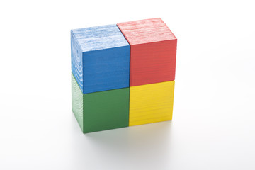 Stack of four colorful cubes isolated on white background.